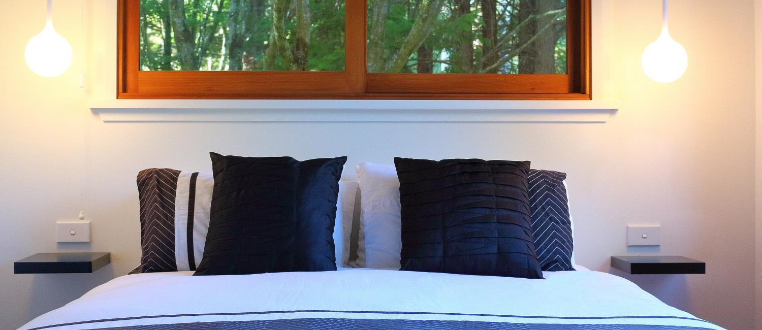 A comfortable Queen sized bed at Murrarang, Medlow Bath. Blue Mountains Accommodation for eight guests.