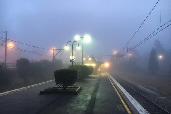 Image of Medlow Bath train station taken at dusk on a foggy morning