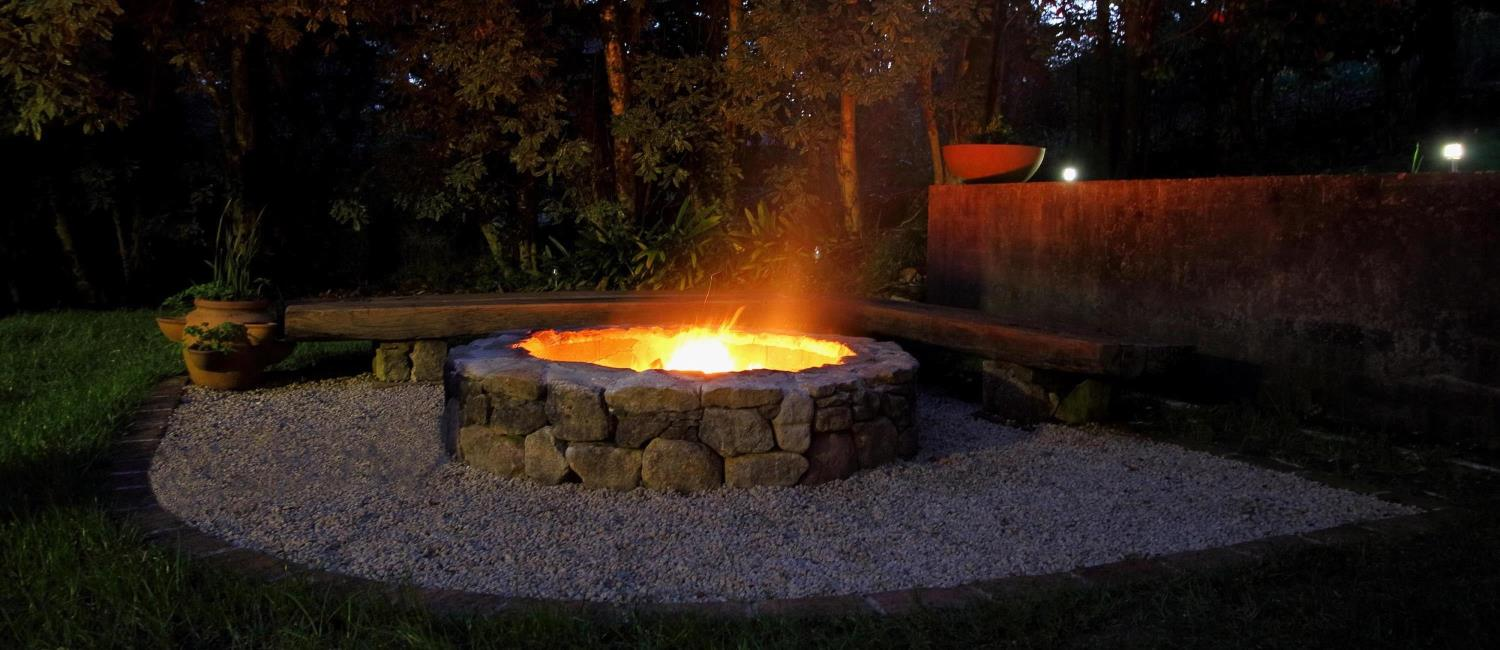 There is an outdoor fireplace at Murrarang, Medlow Bath Blue Mountains